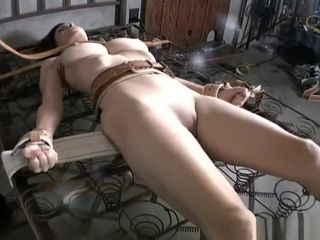 Ashley Renee strapped with medical restraints to naked mattress springs