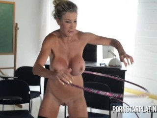 Buxom cougar sex industry star Puma Swede hula hooping bare