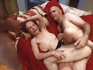 Redhead granny banged by two guys