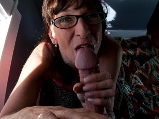 Fantastic cougar dressed in Glasses gargles and jacks A large penis