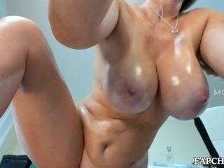 Big boobs milf fingers her bald pussy and squirts