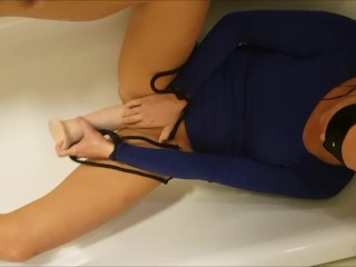 Wifey unbound, laying in the bath drilling her self with the fave plaything