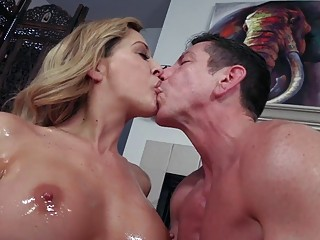 Oiled up blonde MILF strokes dick and rides with passion