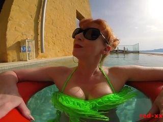 Sexy redhead mature RedXXX poolside blowjob