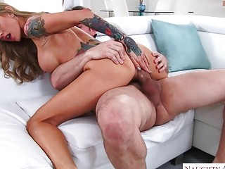 Tattooed MILF with big tits sprayed with cum after fucking