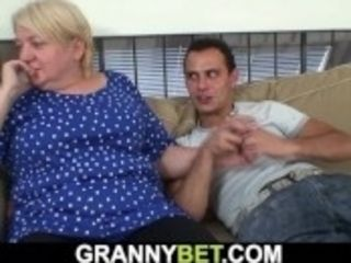 """""""Busty old mature blonde gives head and rides his dick"""""""