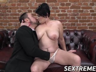 Voluptuous MILF gets banged by handsome young stud on couch
