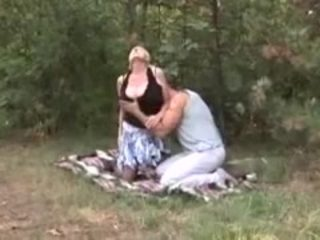 Blonde Granny in stockings fucked in the forest