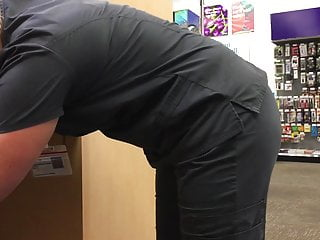 Sexy Blonde in scrubs adjusting her thong