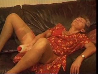 Old and horny granny using a dildo to masturbate