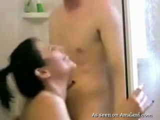 Natural wifey with big boobies stands on knees to give hubby a good BJ