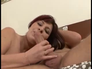 Redheaded married milf  sucking a huge young cock