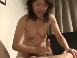 Oriental mature whore is good in bed and she is quite energetic