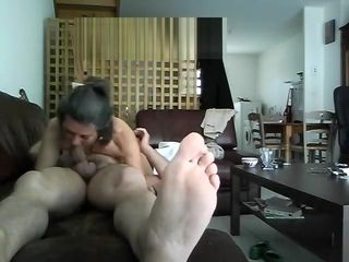 Superslut cougar Carill deep throats on couch and comes covert web cam