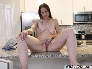 USA cougar Christina Sapphire finger plumbs herself in the kitchen