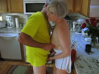Grey haired mature whore lets her hubby play with her small tits