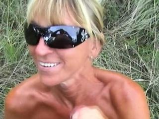 Insatiable GILF wears sunglasses while sucking a cock outdo