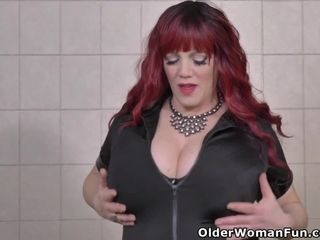 Buxom and Canadian milf Roxee Robinson fingers her pussy