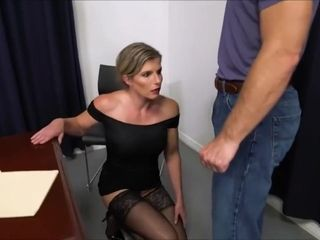 Cory Chase is wearing nothing but black stockings while getting a rear fuck in her office