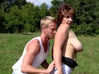 Mature redhead banged in public by her young boyfriend