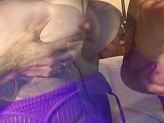 Two beautiful mature babes with huge milk bags have sex