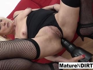 Towheaded mature in fishnets gets her booty crammed with jizz