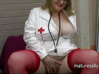 Naughty nurse Sally in her white pvc outfit