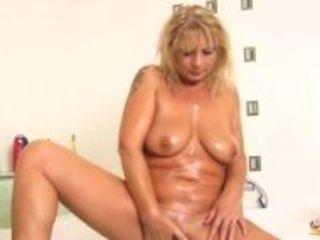 """soapy mom masturbating with showerhead"""