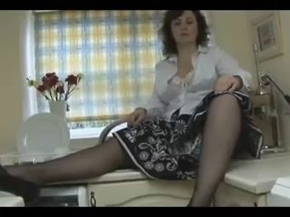 Aged undresses  and shows her arse