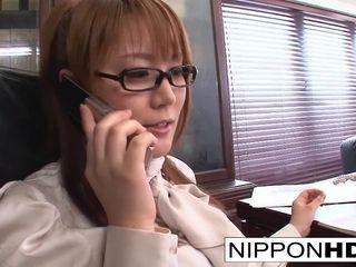 Asian assistant jacks at her desk