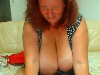 Giant breasted curly red haired BBW is happy to flash her huge knockers