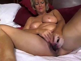 Milf Milf-enjoys jerking with faux-cock on webcam