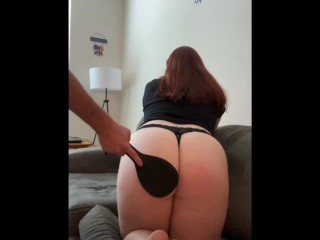 Big booty redhead gets spanked by hand and paddle