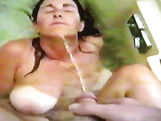 Big Tittied Slut Getting A Golden Shower