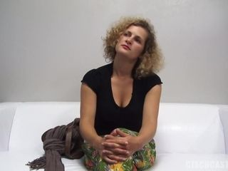 Blonde woman with curly hair is getting fucked during a job interview and moaning while cumming