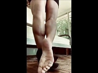 Lady with Beautiful Muscular Calves Raises in High Heels