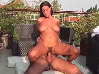 Steaming unshaved nurse outdoor