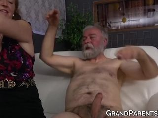 Older couple enjoying wild sex and blowjob in a strip club
