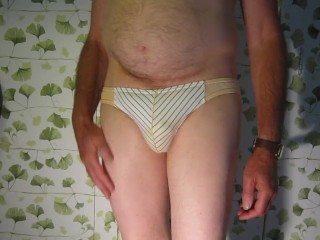 Grandfather David 67 from London chats while undressing to demonstrate his sumptuous trousers