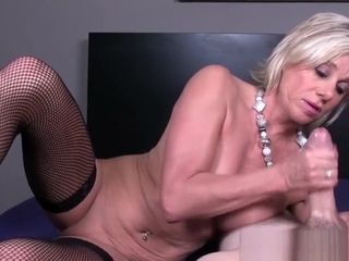 Huge-titted stockinged cougar jerking point of view man rod
