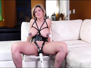 Busty milf strapped with vibrator