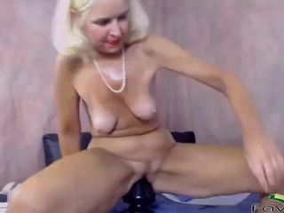 Skilful mature woman stretches old pussy with a huge toy