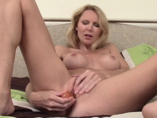 Huge-boobed cougar Plays With Her Peach plaything