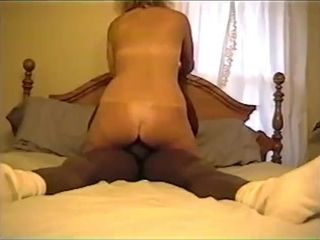 mature blonde wife riding a big black cock
