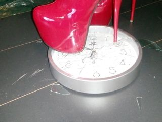 Gal L punch clock with crimson shoes.