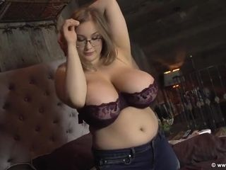 Gorgeous busty babe striping for your pleaure