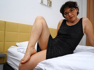 Unshaved mature dame jacking on her sofa